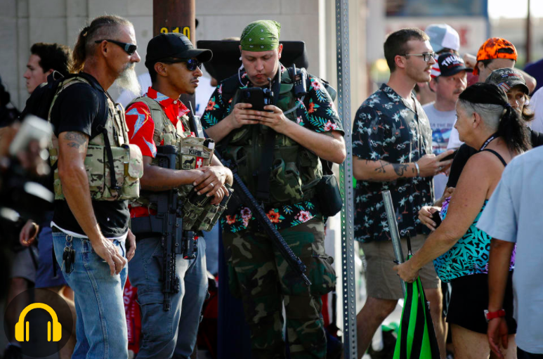 Armed men in Hawaiian shirts ahead of a Trump rally