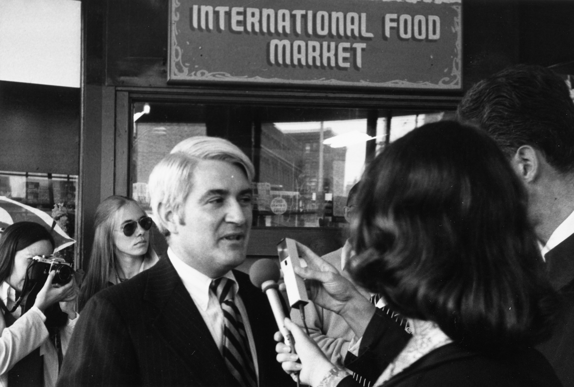 Former Seattle Mayor Wes Uhlman being interviewed in Pike Place Market