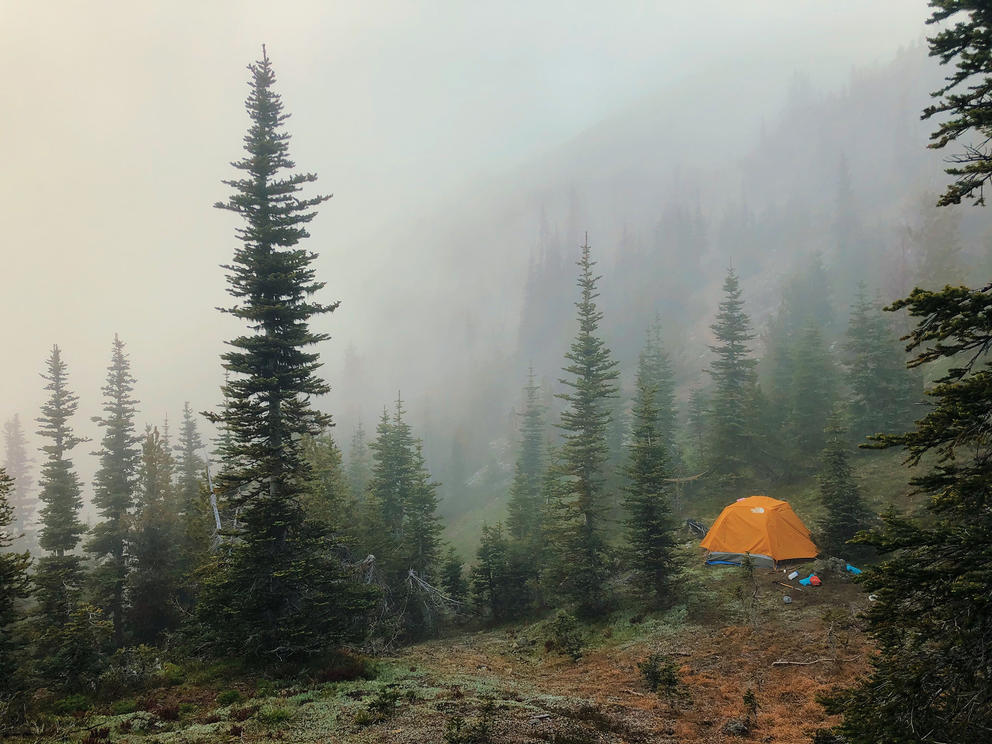 A tent on a mist mountainside