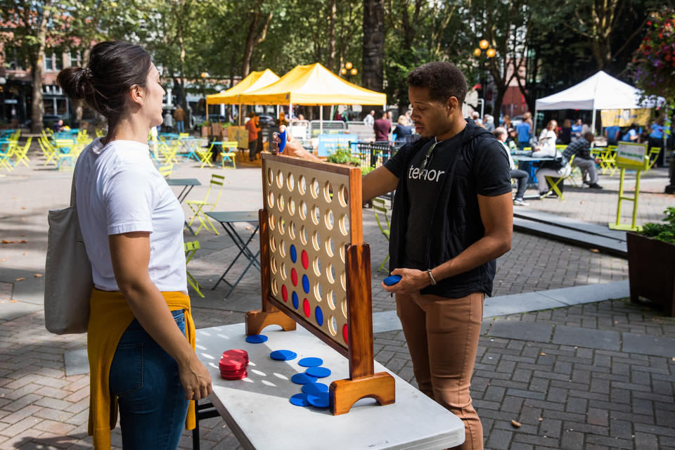 People play Connect Four at Occidental Park in Pioneer Square