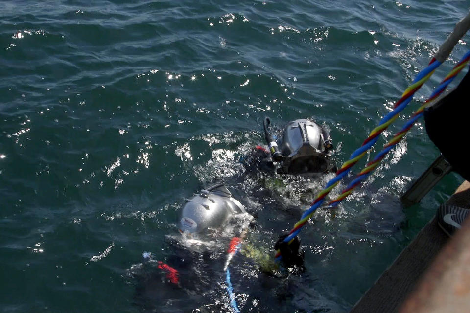 Divers from the Army surface in Puget Sound