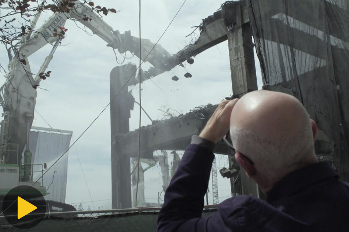 Video still of architect David Miller looks at a partially demolished Seattle Viaduct