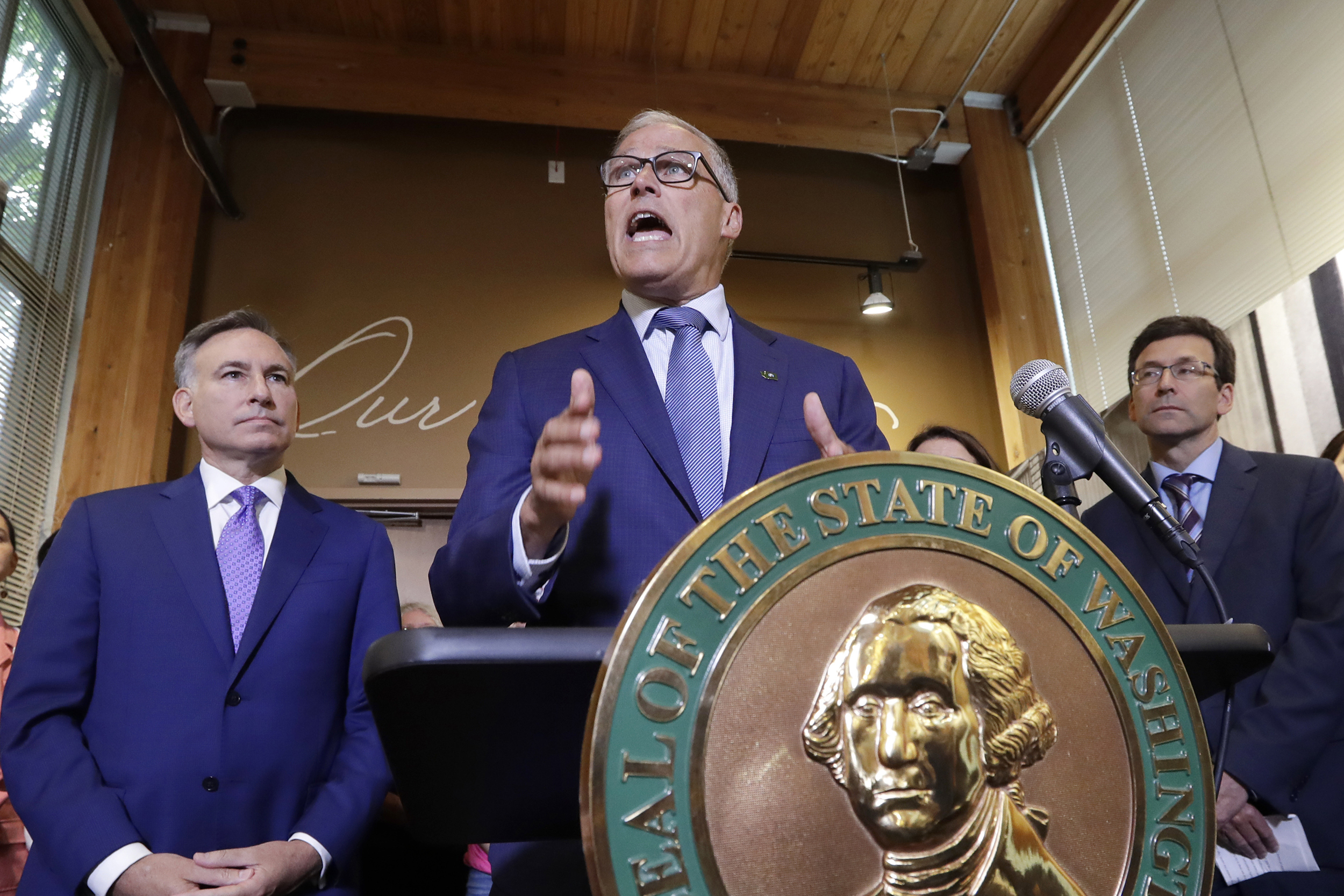 Governor Jay Inslee speaks at a conference